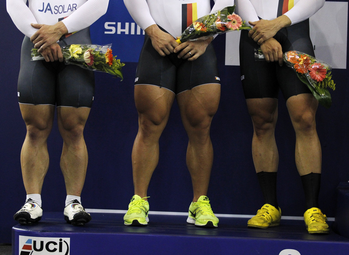 The legs of second placed German team, including Rene Enders, Robert Forstemann and Maximilian Levy are pictured during the ceremony in the men's team sprint race at the 2014 UCI Track Cycling World Championships in Cali. (Jaime Saldarriaga/Reuters)